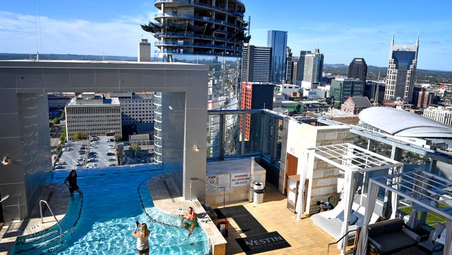 Construction of the JW Marriott Nashville is seen from the rooftop pool and bar area of the Westin Nashville.