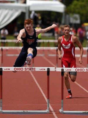 Gallon's Colin McCullough clears the final hurdle on his way to winning the Division II boys 300-meter hurdles Saturday, June 3, 2017, during the state track and field championship at Jesse Owens Memorial Stadium in Columbus.