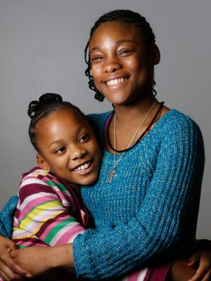 Right now, kids in state custody only receive support until they turn 18, but a bill in the Ohio Legislature would extend that to age 21. Shown are sisters Autumn, 10, and India, 14, who are in the permanent custody of Hamilton County, along with their brother, Charles.