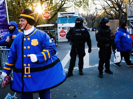 Police take a position along the route before the start of the 92nd annual Macy's Thanksgiving Day Parade in New York, Thursday, Nov. 22, 2018.