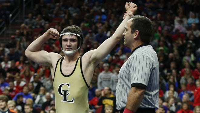Clear Lake junior Ryan Leisure celebrates after pinning Creston senior Wyatt Thompson in the fifth period of their match at 138 pounds during the Class 2A Iowa high school wrestling championships at Wells Fargo in Des Moines.