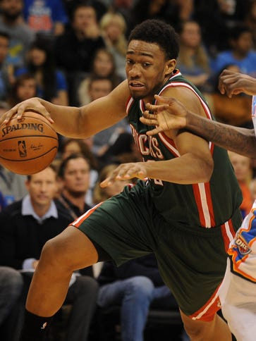 Bucks forward Jabari Parker drives the ball against