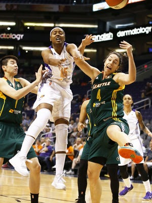 Phoenix Mercury guard Noelle Quinn loses control of the ball against the Seattle Storm.