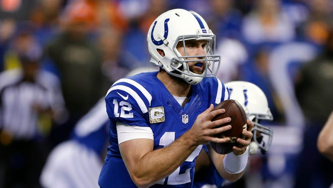 Indianapolis Colts quarterback Andrew Luck (12) throws a pass against the Denver Broncos at Lucas Oil Stadium.