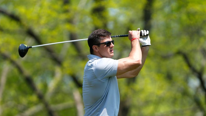 Ryan Kerrigan with the drive on No. 18 of the Kampen Course during the Ryan Kerrigan/12th Boiler Golf Outing Friday, May 6, 2016, at the Birck Boilermaker Golf Complex. The former Purdue great now stars for the Washington Redskins.