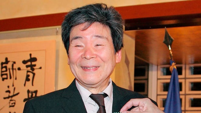 In this April, 2015, photo,  Isao Takahata, co-founder of the prestigious Japanese animator Studio Ghibli, receives Officer of the French Order of Arts and Letters in Tokyo.