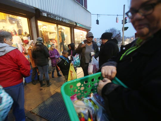 People gather up some supplies and food, during Christmas