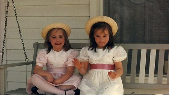 Abbey Doyle and twin sister Sarah Spurgeon sitting