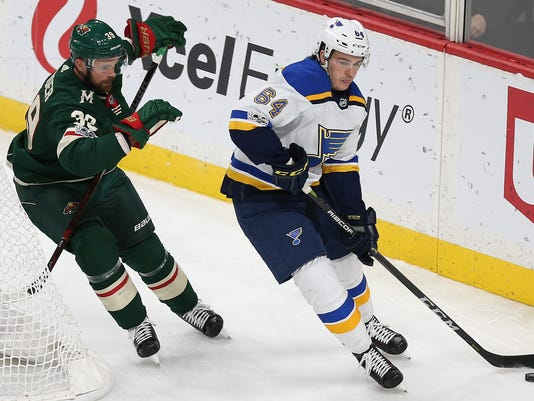 St. Louis Blues' Sammy Blais (64) controls the puck against Minnesota Wild's Nate Prosser (39) during the third period of an NHL hockey game Saturday, Dec. 2, 2017, in St. Paul, Minn. The Wild won 2-1 in overtime. (AP Photo/Stacy Bengs)