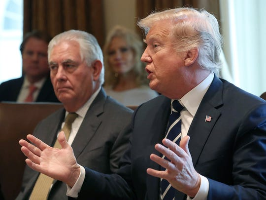 President Trump, right, joined by Secretary of State Rex Tillerson speaks to the media during a meeting with his Cabinet at the White House on Oct. 16, 2017 in Washington, D.C.