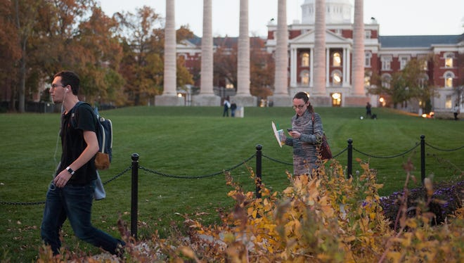 Students walk along the campus of the University of Missouri in Columbia on Nov.10, 2015.