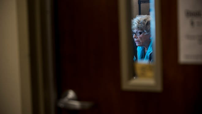 Dot Moore reads aloud stories in the Montgomery Advertiser on Wednesday, Jun. 8, 2016 at the Troy Public Radio station in Montgomery, Ala. The station has about 10 volunteers who read the newspaper to blind listeners.