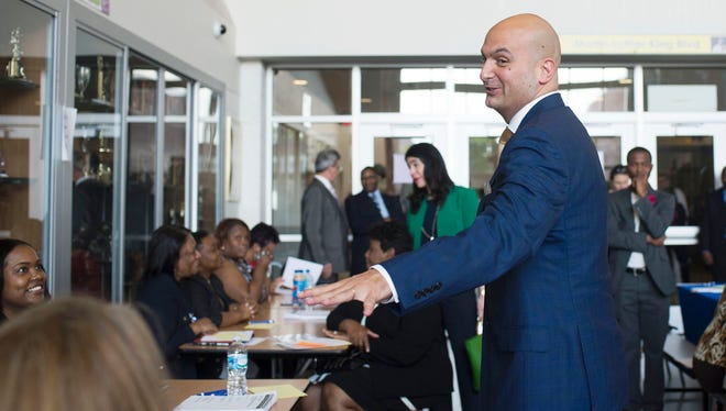 New Detroit Superintendent Nikolai Vitti greets people during the DPSCD Teacher Recruitment Fair on Tuesday, May 23, 2017 at Martin Luther King High School in Detroit. Vitti attended the Fair as part of his first day as Superintendent.