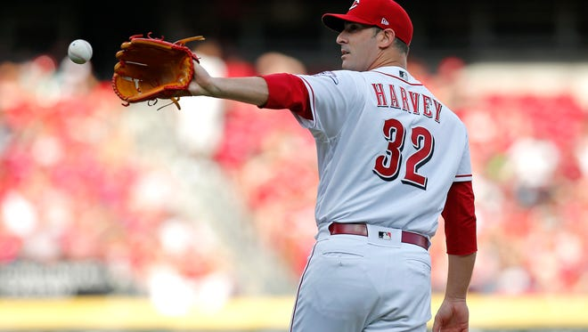 Cincinnati Reds starting pitcher Matt Harvey (32) returns to the mound between pitches in the top of the second inning of the MLB National League game between the Cincinnati Reds and the Philadelphia Phillies at Great American Ball Park in downtown Cincinnati on Saturday, July 28, 2018.