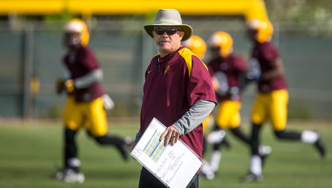 Head coach Todd Graham keeps an eye on the players during the second day of ASU's spring football practice at Bill Kajikawa Football Practice Fields in Tempe on Thursday, March 20, 2014.