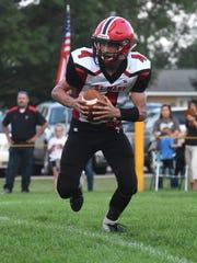 Dell Rapids St. Mary Connor Libis (4) runs the ball