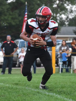 Dell Rapids St. Mary Connor Libis (4) runs the ball during a game against Colman-Egan on Friday, Aug. 31, 2018 at Colman-Egan High School.