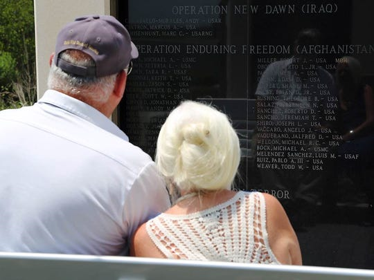 Donn and Jeanne Weaver of Cocoa Beach visit the memorial after their son's name, 1st. Lt. Todd Weaver, was added