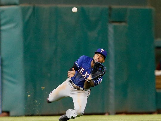 Texas outfielder Delino DeShields makes a diving attempt
