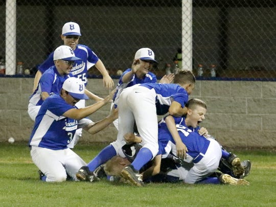 Horseheads players celebrate their 25-1 win over Fayetteville-Manlius in the Section 1 East Little League 10-12 championship game Thursday night at Horseheads.