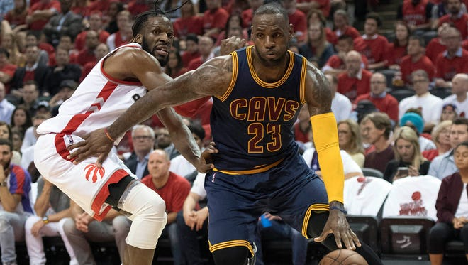 Cleveland Cavaliers forward LeBron James (23) drives to the basket as Toronto Raptors forward DeMarre Carroll (5) tries to defend during the third quarter of game six of the Eastern conference finals of the NBA Playoffs.