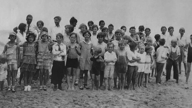 Students from the Flagler Beach School pay a visit to the beach in the late 1920s. Their clothing suggests that some were there for swimming, but most were there for visiting.