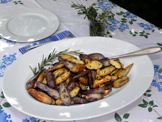 Fingerling potatoes are roasted with herbs and olive