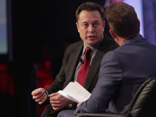 Elon Musk, CEO,Tesla Motors speaks during the Automotive