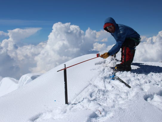 Blaine Horner of CompassData probes the snowpack at
