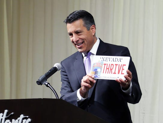 Gov. Brian Sandoval presents Thrive Market a commemorative