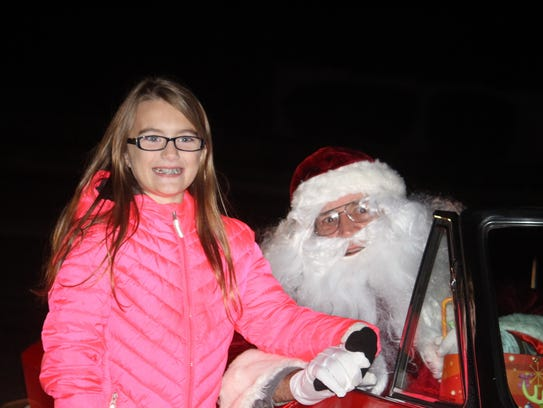 Megan Nichols, 9, wasn't shy as she chatted with Santa