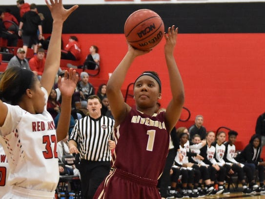 Riverdale's Alasia Hayes shoots as Stewarts Creek's