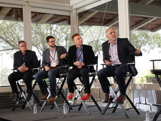 From left, SVG Partner's John Hartnett, Geoff Risenberg