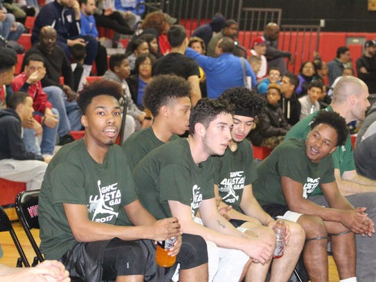Green team takes in the action.