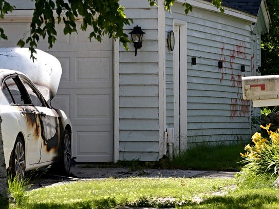 Graffiti including swastikas was found on the side of a garage on Sheboygan's west side June 21, 2017. The site was also the scene of an early-morning vehicle fire.