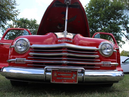 A 1947 Plymouth Roadrunner is on display.