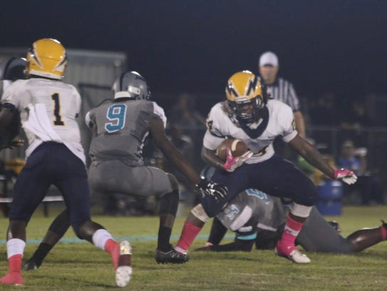 Lehigh's Chris Curry tries to elude an East Lee defender