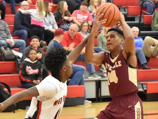 Deron Perry (14) scored 20 points in Riverdale's 68-51 win over Stewarts Creek Friday.