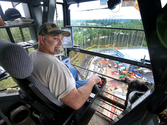 Phillip Fox of Howard S. Wright Construction runs the crane on the construction site of Harrison Medical Center in Silverdale.