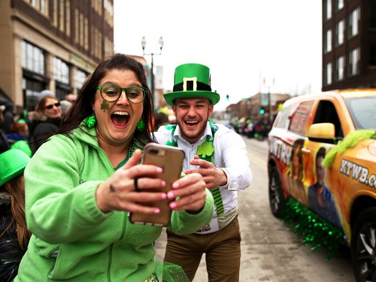 Sara Romeo takes a selfie with a man dressed as a leprechaun