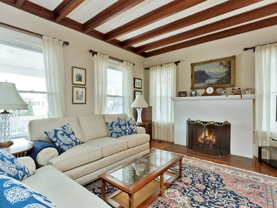 Enjoy a relaxing moment in the living room that offers warmth from the fireplace.