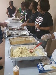Church members pass out food.