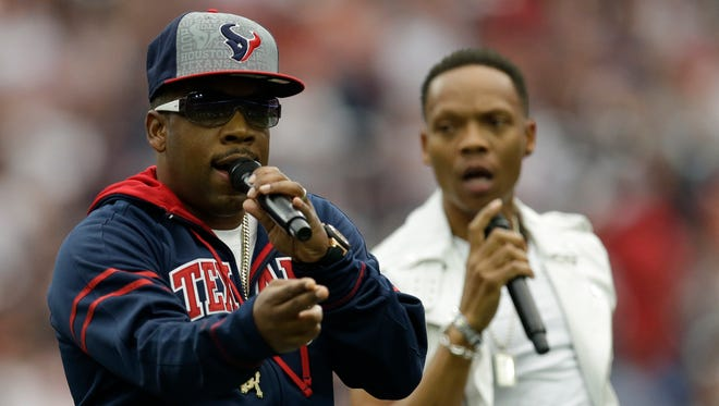 The group Bell Biv Devoe performs at halftime of an NFL football game Sunday, Sept. 13, 2015, in Houston.