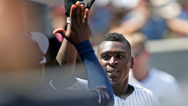 Teammates greet New York Yankees' Didi Gregorius after he hit a fourth-inning solo home run in a baseball game against the Cleveland Indians, Sunday, Aug. 7, 2016, in New York