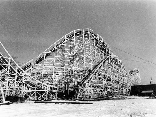 Before photos of the Cyclone, a wooden roller coaster at the park.
