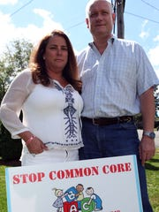 Glen Dalgleish and Yvonne Gasperino stand next to a