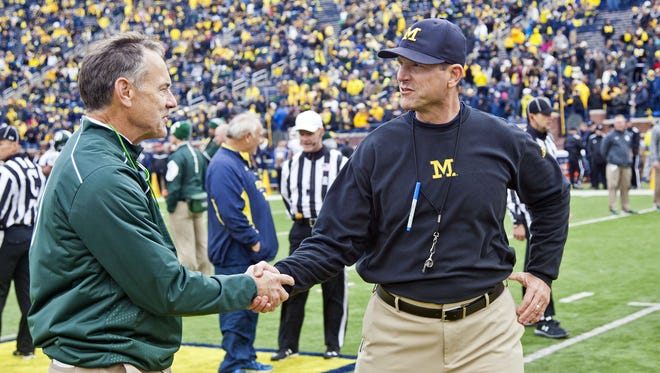 Mark Dantonio, left, and Jim Harbaugh prior to the 2015 game.