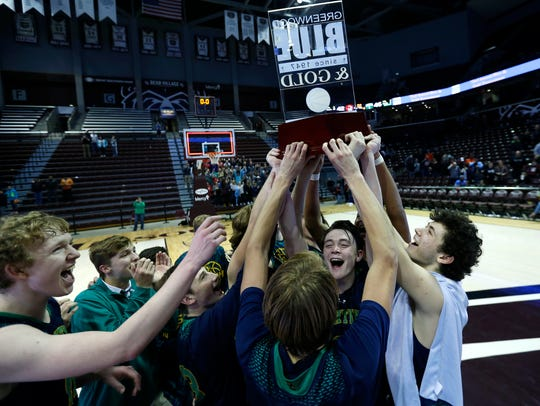 The Springfield Catholic Fightin' Irish hoist the Gold