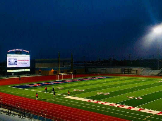 The lights of Ray Akins Wildcat Stadium were lit from dusk Tuesday until dawn to honor the former coach for whom the facility is named. Akins, who coached Gregory-Portland High's football team for more than three decades, died on Tuesday.