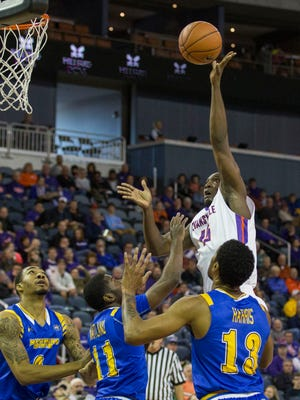 UE's Dalen Traore (15) puts the ball up to score against Morehead State during Saturday afternoon's game at the Ford Center.